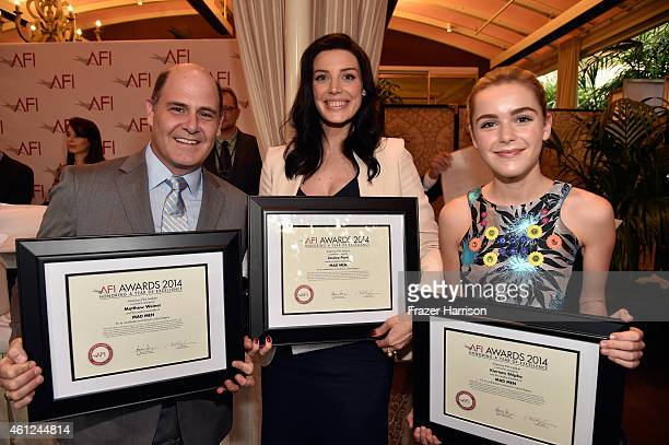 Creator Matthew Weiner actor Jessica Pare and actor Kiernan Shipka pose with award during the 15th Annual AFI Awards at Four Seasons Hotel Los...