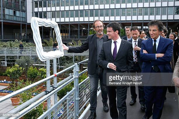 Creator of the 'Anamorphose' Anamorphosis Francois Abelanet French Prime Minister Manuel Valls and President of the 'Institut du Monde Arabe' Jack...