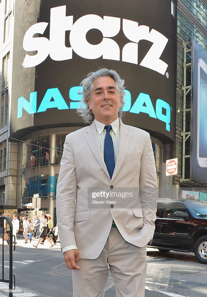 Creator/writer Mitch Glazer poses outside of NASDAQ at Times Square on June 12, 2013 in New York City.