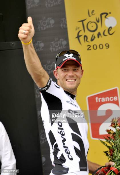 Credit Agricole's Thor Hushvold celebrates winning the sixth stage of the Tour de France between Gerone and Barcelona