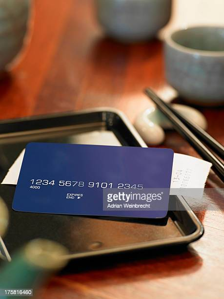 Credit card and bill on restaurant table