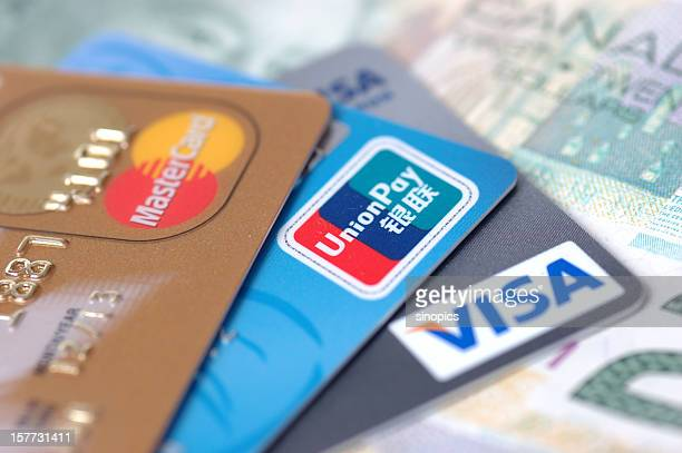 credit card and Canada dollar bill
