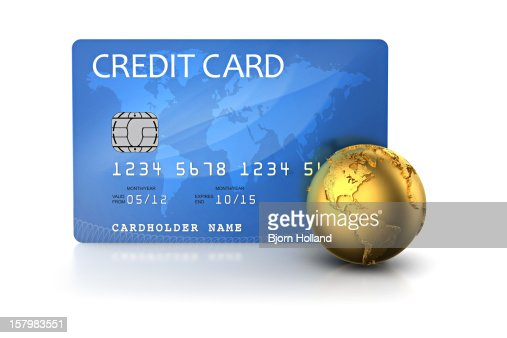 Credit card and golden globe : Stock Photo