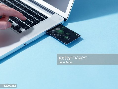 Credit card and laptop computer : Stock Photo
