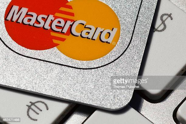 Credit card master card on a keyboard next to a dollar and euro symbol on December 10 2014 in Berlin Germany
