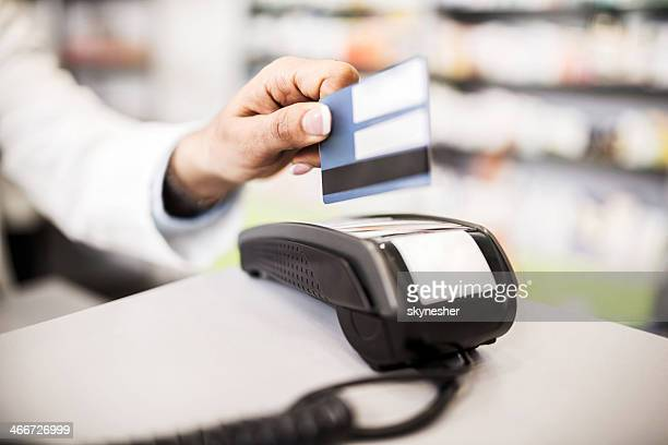 Credit card payment in pharmacy.