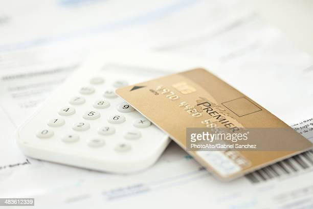 Credit card resting on calculator