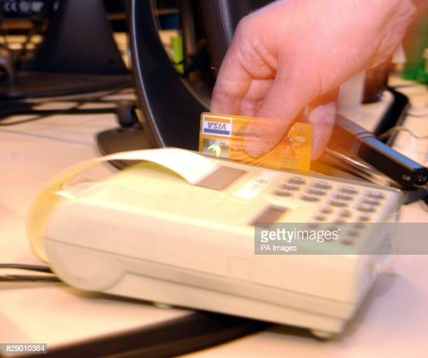 A credit card transaction Consumers continue to find credit cards 'irresistible' with outstanding debt soaring by 62% during the past four years a...