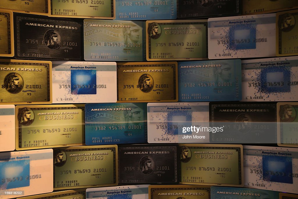 Credit cards fill a window display at American Express headquarters on January 11, 2013 in New York, New York. Following low fourth quarter earnings, the credit card giant announced plans to cut 5,400 jobs in the coming year.