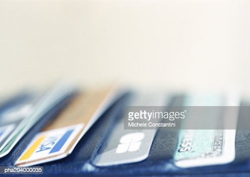 Credit cards protruding from wallet.