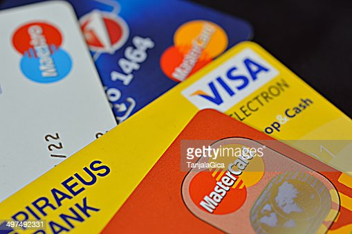 credit cards stack including visa, master and maestro