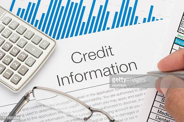 Credit information form with blue lined chart and calculator