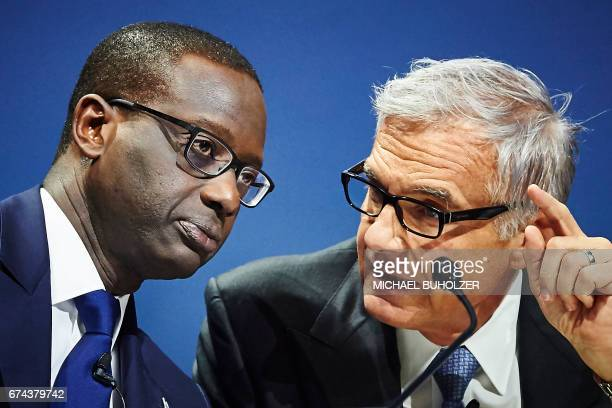 Credit Suisse CEO Tidjane Thiam and chairman Urs Rohner attend the annual shareholders' meeting of the Swiss banking group on April 28 2017 in Zurich...