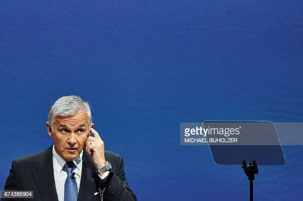 Credit Suisse chairman Urs Rohner gestures as he delivers a speech during the annual shareholders' meeting of the Swiss banking group on April 28...