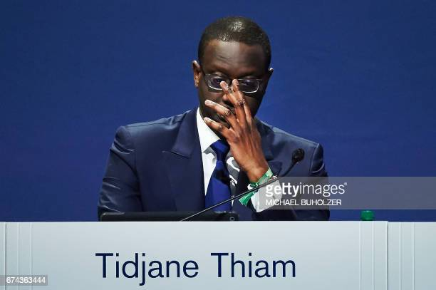 Credit Suisse chief executive officer Tidjane Thiam gestures as he addresses the annual shareholders meeting of the Swiss banking group in Zurich on...