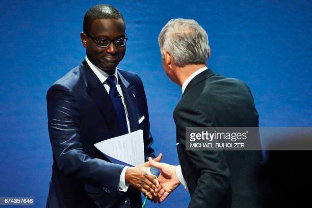 Credit Suisse chief executive officer Tidjane Thiam shakes hands with chairperson Urs Rohner during the annual shareholders meeting of the Swiss...