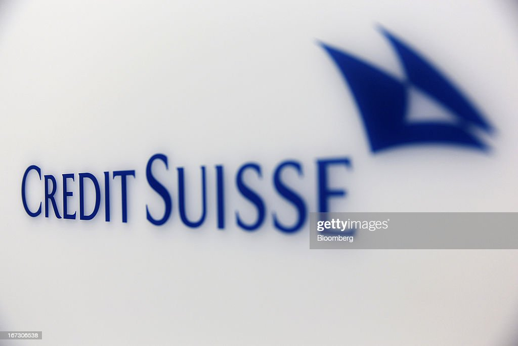 A Credit Suisse logo sits on a wall of the headquarters of Credit Suisse Group AG, in Zurich, Switzerland, on Wednesday, April 24, 2013. Credit Suisse Group AG, the second- biggest Swiss bank, posted a jump in first-quarter profit as year-earlier charges related to its own debt and bonus payments weren't repeated. Photographer: Gianluca Colla/Bloomberg via Getty Images