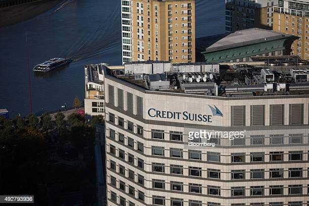 A Credit Suisse logo sits on their offices in London UK on Wednesday Oct 14 2015 Britain's inflation rate turned negative for only the second time...