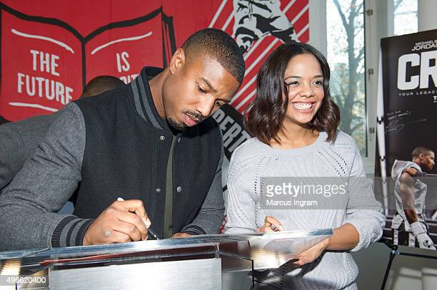 'Creed' stars Michael B Jordan and Tessa Thompson signing autographs during the Big Brothers Big Sisters of Metro Atlanta mural unveiling on November...