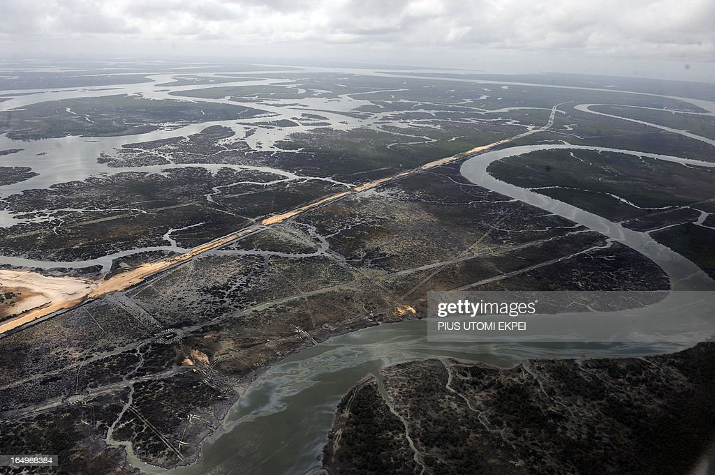 Creeks and vegetations devastated as a result of spills from oil thieves in the Niger Delta on March 22, 2013. Shell Petroleum Development Company of Nigeria (SPDC) has threatened to shut down production in April for nine days in the entire Nembe Creek Truck Line (NCTL) to remove a number of bunkering points on pipelines vandalised by oil thieves in the region. 'Whenever we observe a spill, or have a spill on our lines, we shut down production to depressurize and isolate the line, only then can we safely repare our lines because it is then safe to manipulate the line', said Jurgen Jonzen, SPDC corporate pipeline asset manager. Last year, 157 bunkering points were removed and 116 were leaking on the whole SPDC exploitation. Since 2009, SPDC has exprienced an upsurge in vandalisation of pipeline network by criminals causing severe environmental devastation of the region and forcing the company to lose 60 000 barrels daily this year.