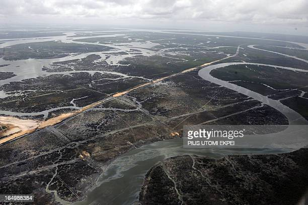 Creeks and vegetations devastated as a result of spills from oil thieves in the Niger Delta on March 22 2013 Shell Petroleum Development Company of...
