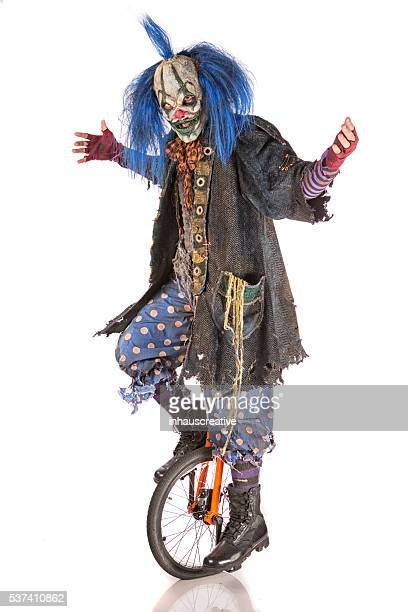 Creepy Clown riding unicycle