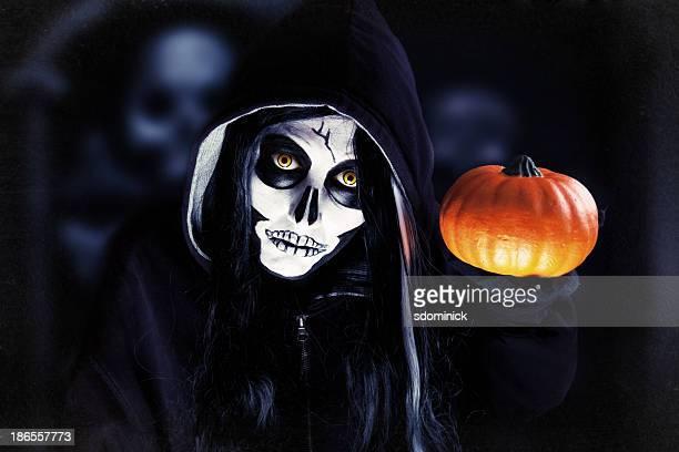 Creepy Halloween Skeleton Holding Pumpkin