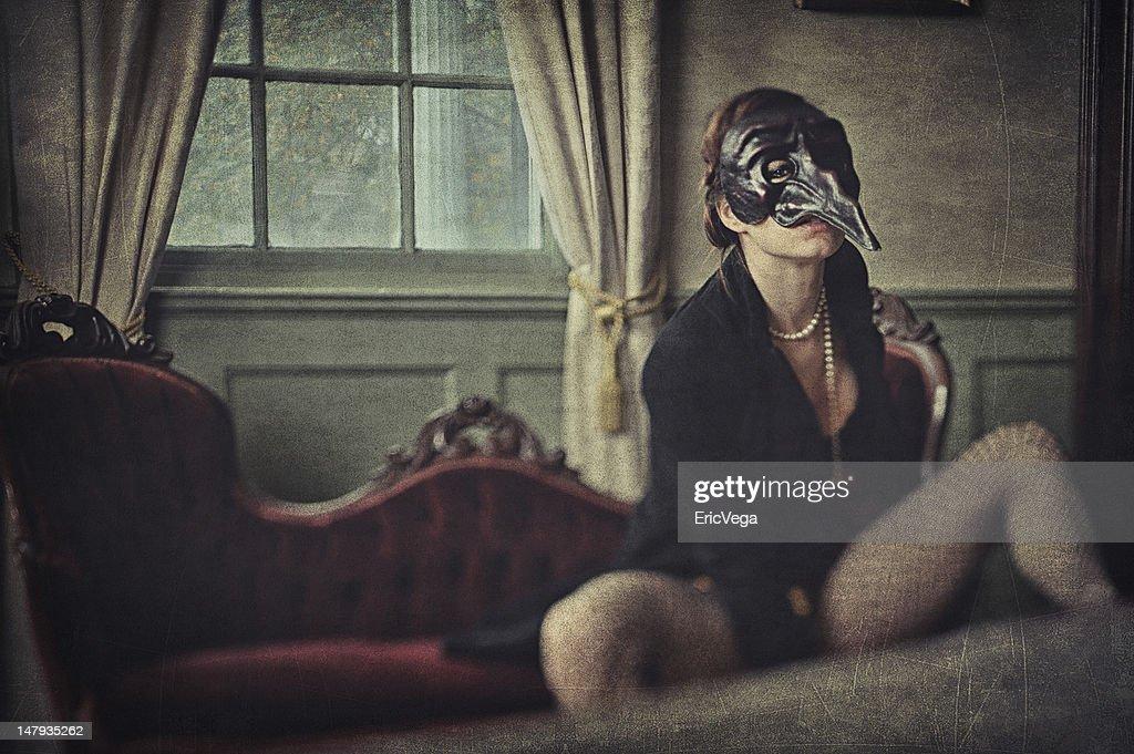 Creepy woman wearing a bizarre mask