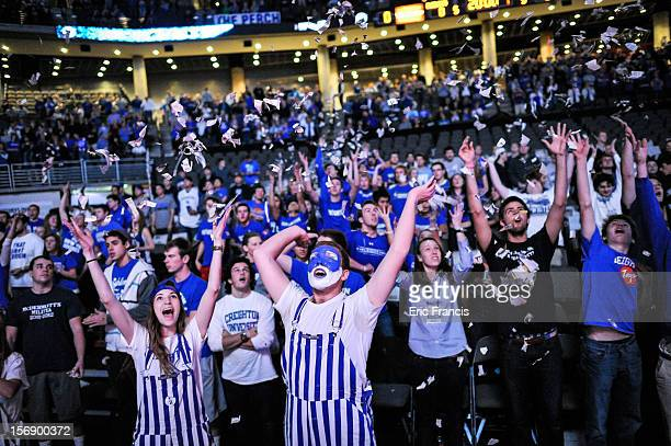 Creighton Bluejay fans cheer their team introduction during their game against Presbyterian Blue Hose at CenturyLink Center on November 18 2012 in...