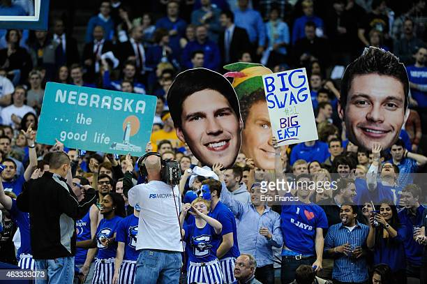 Creighton Bluejay fans hold signs during their game against the Marquette Golden Eagles at the CenturyLink Center on December 31 2013 in Omaha...