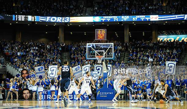 Creighton Bluejay fans react after a three point basket during their game against the Xavier Musketeersat the CenturyLink Center on January 12 2014...