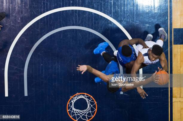 Creighton Bluejays center Justin Patton blocks a shot by Butler Bulldogs forward Kelan Martin in the lane during the men's college basketball game...