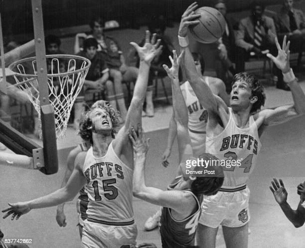 Creighton Head and Fingers above Teammate for Rebound Jim Creighton of Colorado reaches high to get one of 10 rebounds as ball bounces over head of...