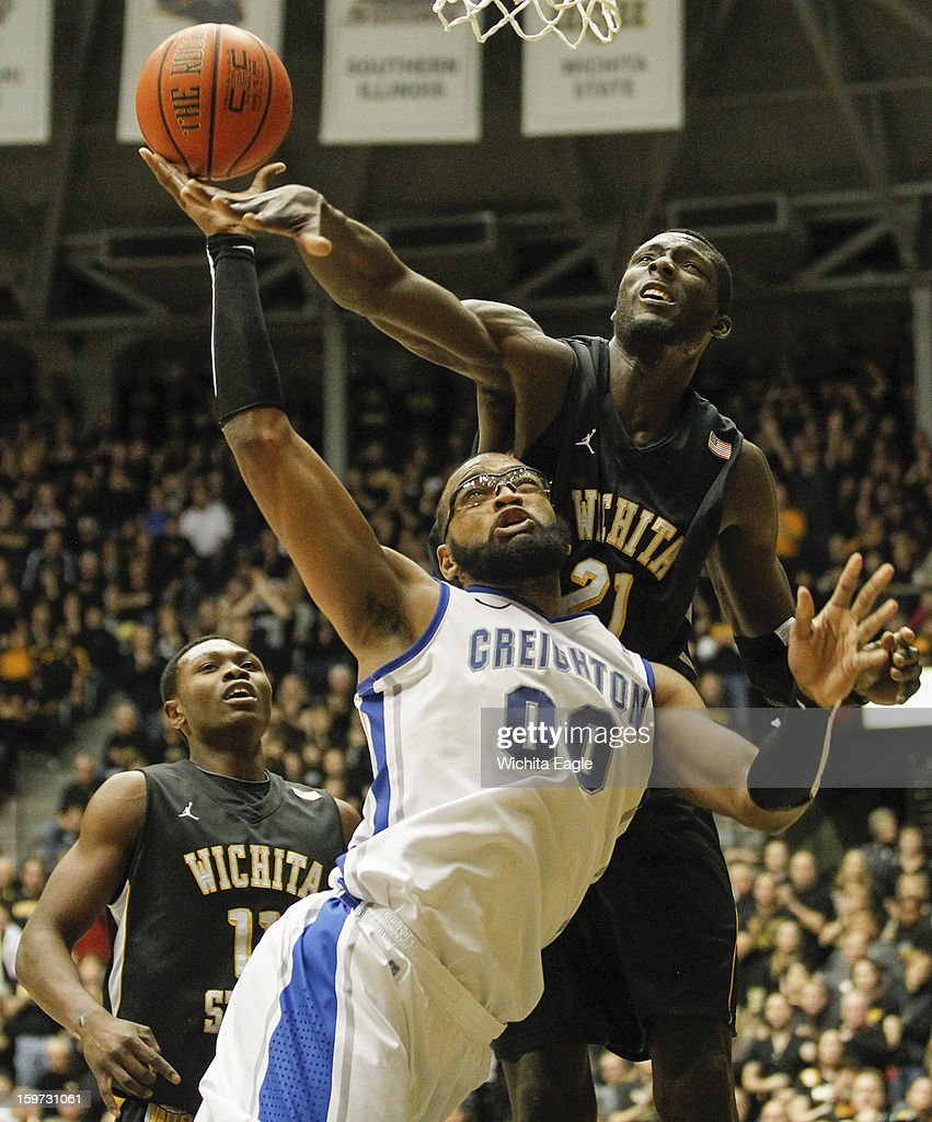 Creighton's Gregory Echenique (00) fights for a rebound during the first half against Wichita State's Ehimen Orukpe on Saturday, January 19, 2013, at Koch Arena in Wichita, Kansas.
