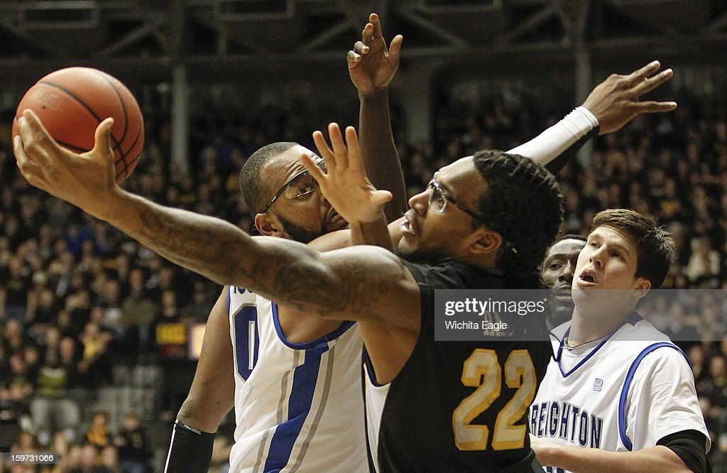 Creighton's Gregory Echenique, left, fights for a rebound during the first half against Wichita State's Carl Hall (22) on Saturday, January 19, 2013, at Koch Arena in Wichita, Kansas.