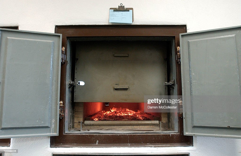 A cremation in progress at Mount Auburn Cemetary is shown February 21 2002 in Watertown MA The blue card above the oven is an identification card...