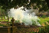 cremation scene smoke in a graveyard