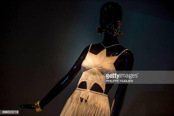CrepeGeorgette summer dress with a starshaped pleated bodice by French fashion designer Hubert de Givenchy is pictured during an exhibition dedicated...