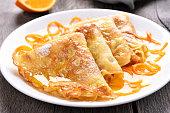 Crepes Suzette with orange sauce, close up view
