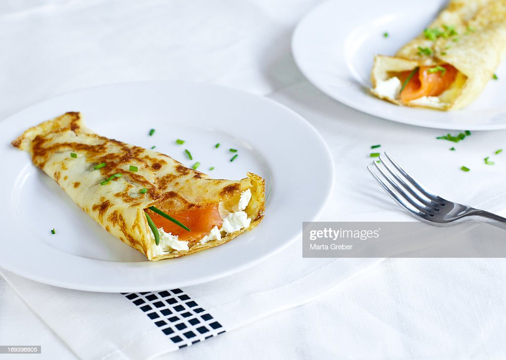 Crepes with cream cheese and salmon : Stock Photo