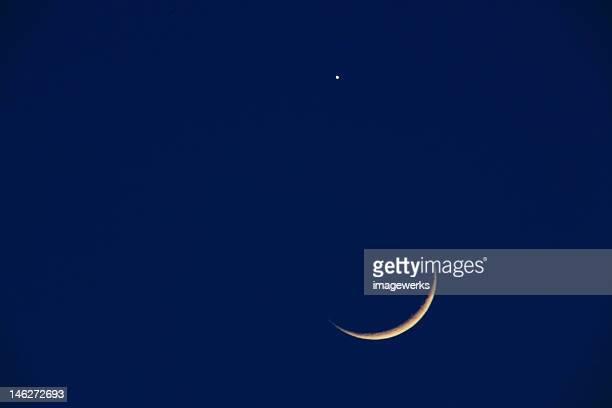 Crescent moon in night sky
