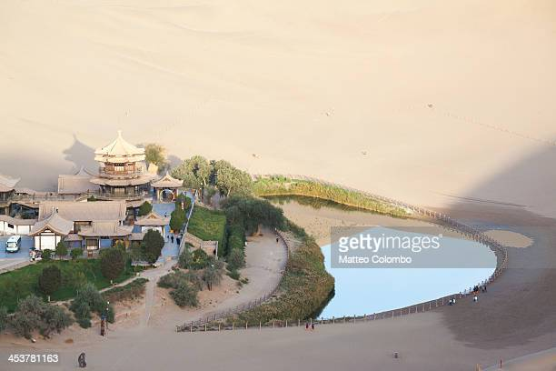 CONTENT] Crescent moon lake is a crescentshaped lake in an oasis near the famous Dunes of singing sand 6 km south of the city of Dunhuang on the...