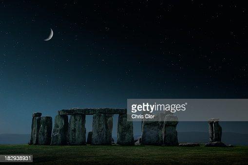 Crescent moon over Stonehenge monument, Wiltshire, United Kingdom