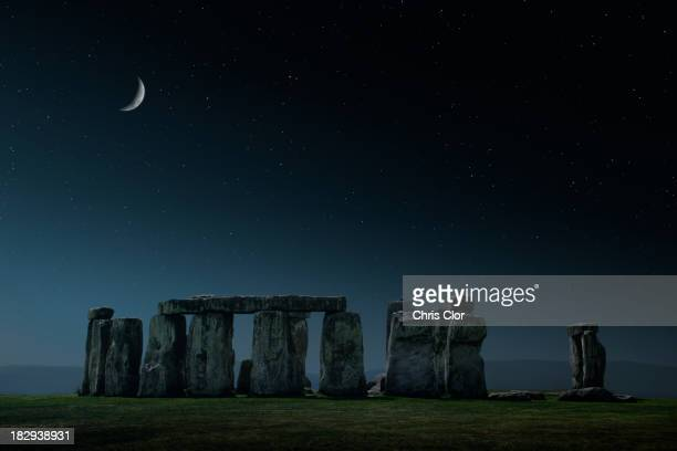 Crescent moon over Stonehenge monument, Wiltshire, United Kingdom