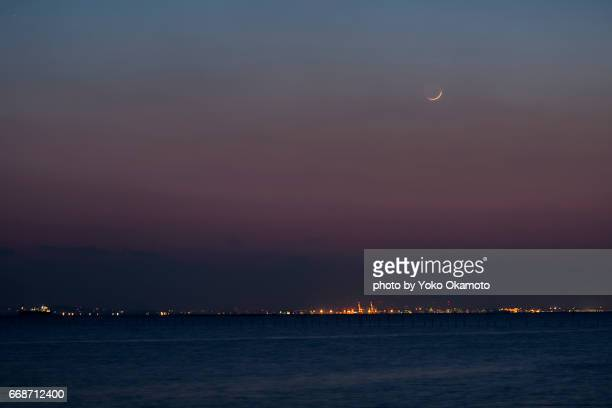 Crescent moon sinking in Tokyo Bay