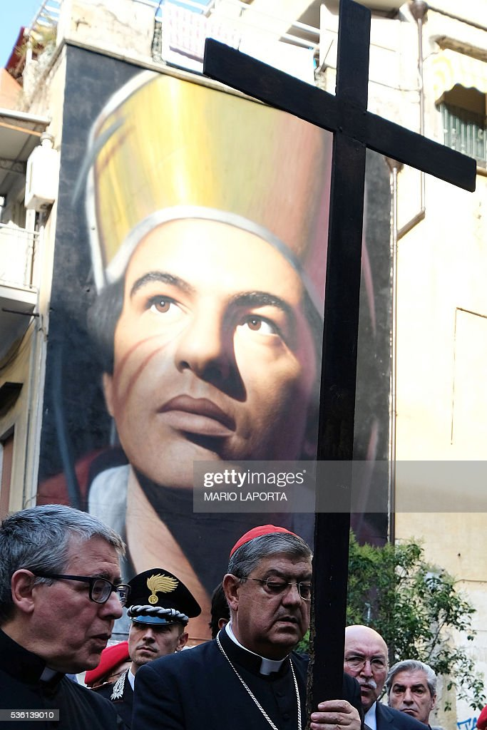Crescenzio Sepe, the Archbishop of Naples, carries a cross during a procession against Neapolitan mafia (Camorra), on May 31, 2016. LAPORTA