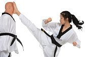 Martial artist executing a high cresent kick.