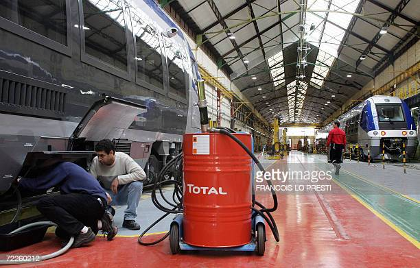 Men work on trains at the Bombardier factory 25 October 2006 in Crespin northern France Bombardier of Canada won a 40billioneuro contract to build...