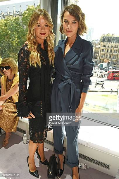 Cressida Bonas and Alexa Chung attend the Topshop Unique show during London Fashion Week SS16 at The Queen Elizabeth II Conference Centre on...