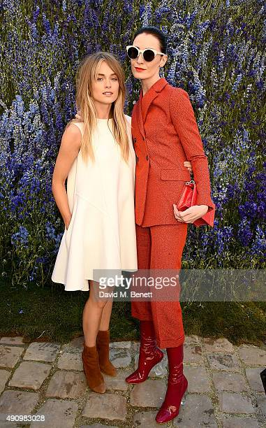Cressida Bonas and Erin O'Connor attend the Christian Dior show as part of the Paris Fashion Week Womenswear Spring/Summer 2016 on October 2 2015 in...